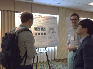 Yimeng Chen and Travis Rampton present a poster.